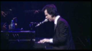 Смотреть клип песни: Nick Cave & The Bad Seeds - God Is In The House